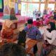 Bupati Bangkalan R Abdul Latif Amin Imron bersama isteri Zaenab Zuraidah melakukan pemeriksaan tekanan darah di lokasi pengobatan gratis, Selasa (12/11/2019)
