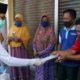 Bupati Bangkalan, R Abdul Latif Amin Imron saat memberikan bantuan